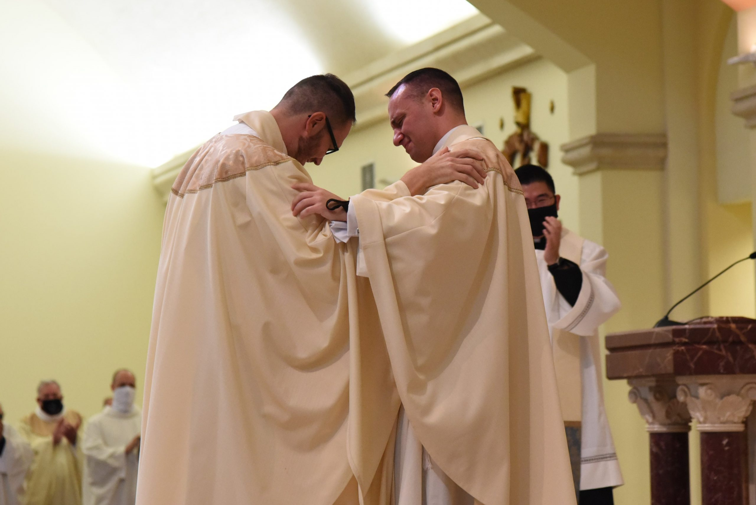 Two men, eager and ready, are Ordained to the Priesthood